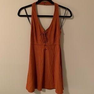 Suede halter swing dress.